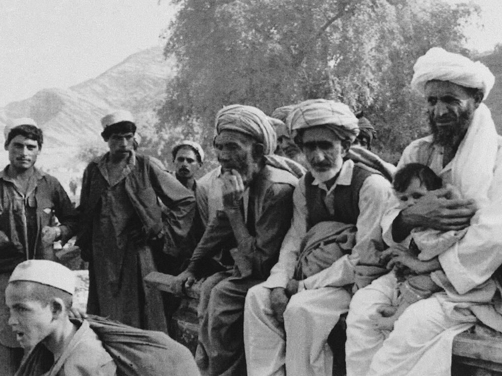 Afghan families break their homeward journey from Pakistan at the border town of Torkham in 1992, a year when many refugees began to return to Afghanistan. Civil war broke out soon thereafter, causing more to flee the country again.