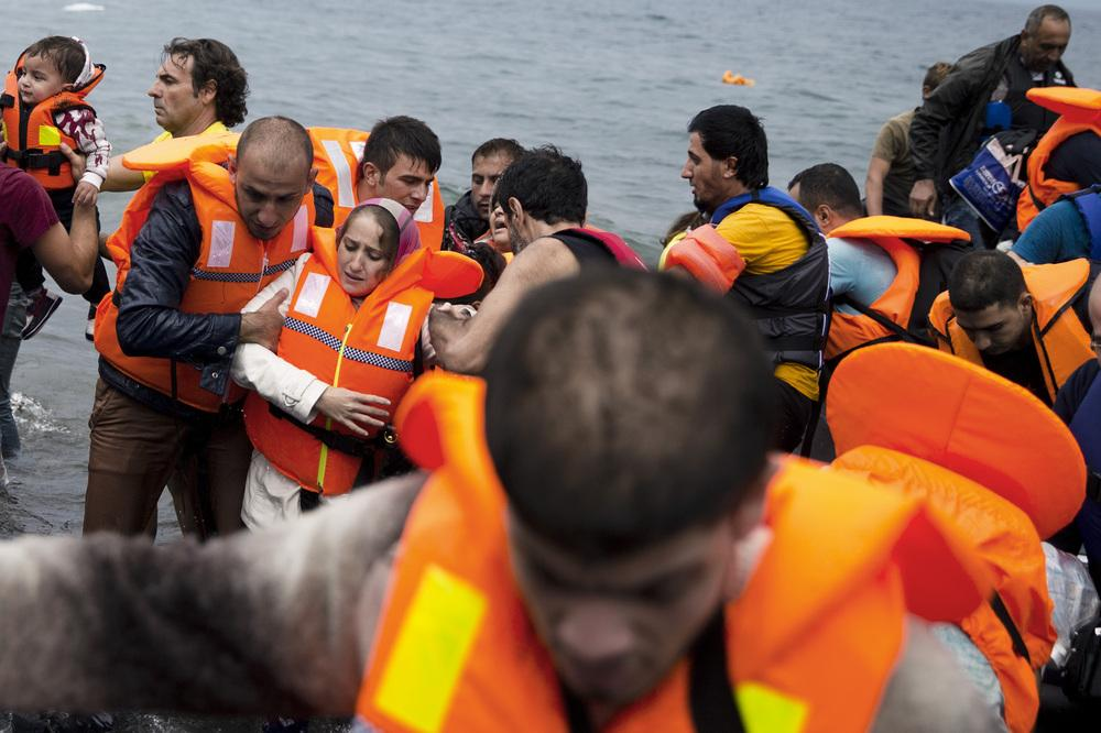 Syrian refugees arrive on the Greek island of Lesbos after crossing the Aegean Sea from Turkey on Tuesday.