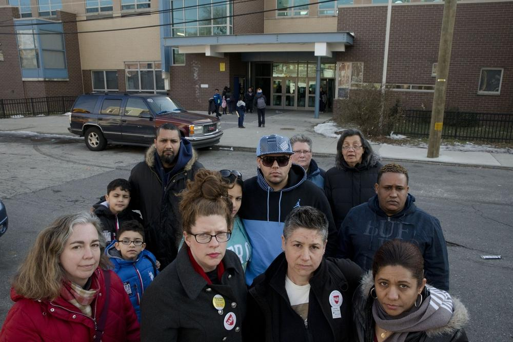 Pennsylvania: Feltonville School of Arts and Sciences teachers, parents and students pose for a portrait in Philadelphia. Nearly 20 percent of students at a Philadelphia middle school won't be taking the state's annual standardized tests after teachers in