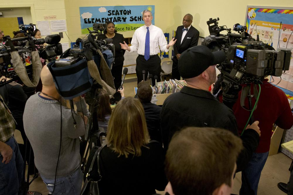 Washington, D.C.: Education Secretary Arne Duncan answers questions after speaking about the administration's priorities for education at Seaton Elementary in Washington. Duncan said that testing U.S. schoolchildren annually in math and reading is critica