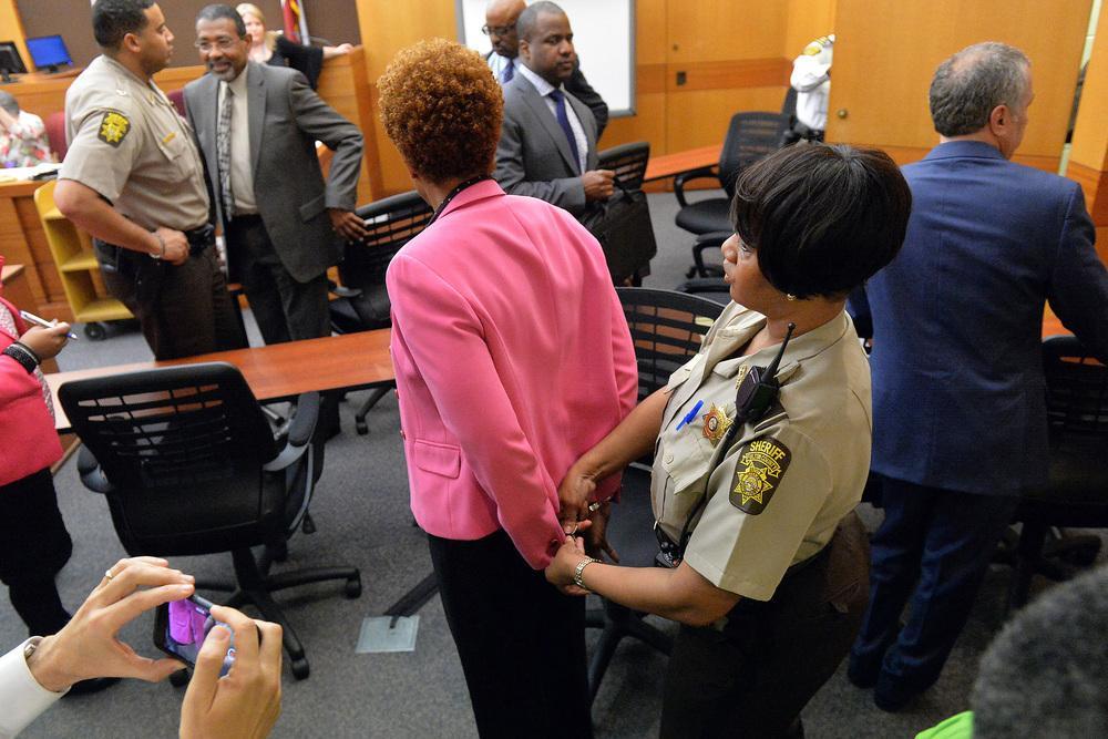 Georgia: A Fulton County sheriff's deputy handcuffs former Atlanta Public Schools school research team director Sharon Davis Williams after a jury found her guilty in the Atlanta Public Schools test-cheating trial.