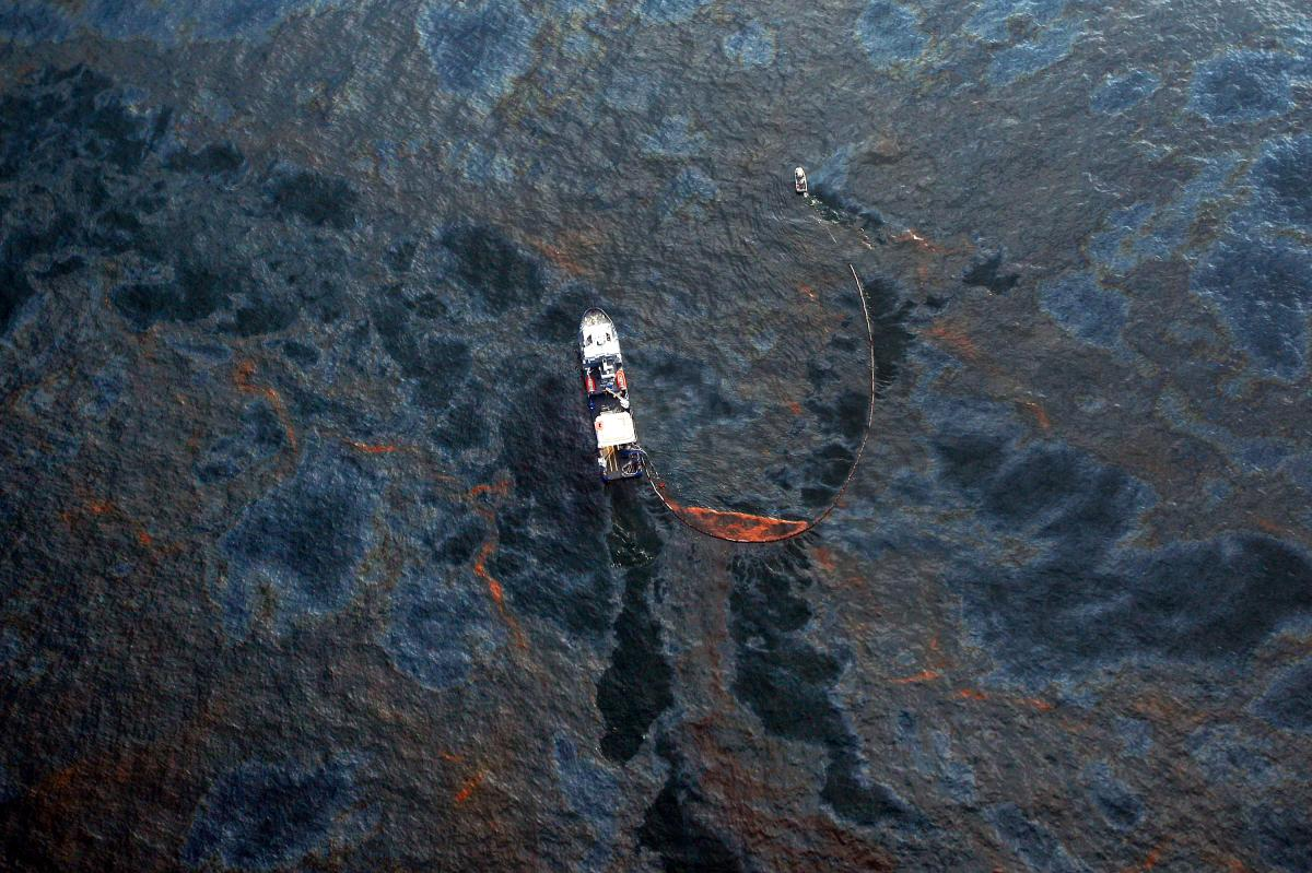 A boat collects oil that leaked from the Deepwater Horizon wellhead in the Gulf of Mexico in April 2010 near New Orleans.