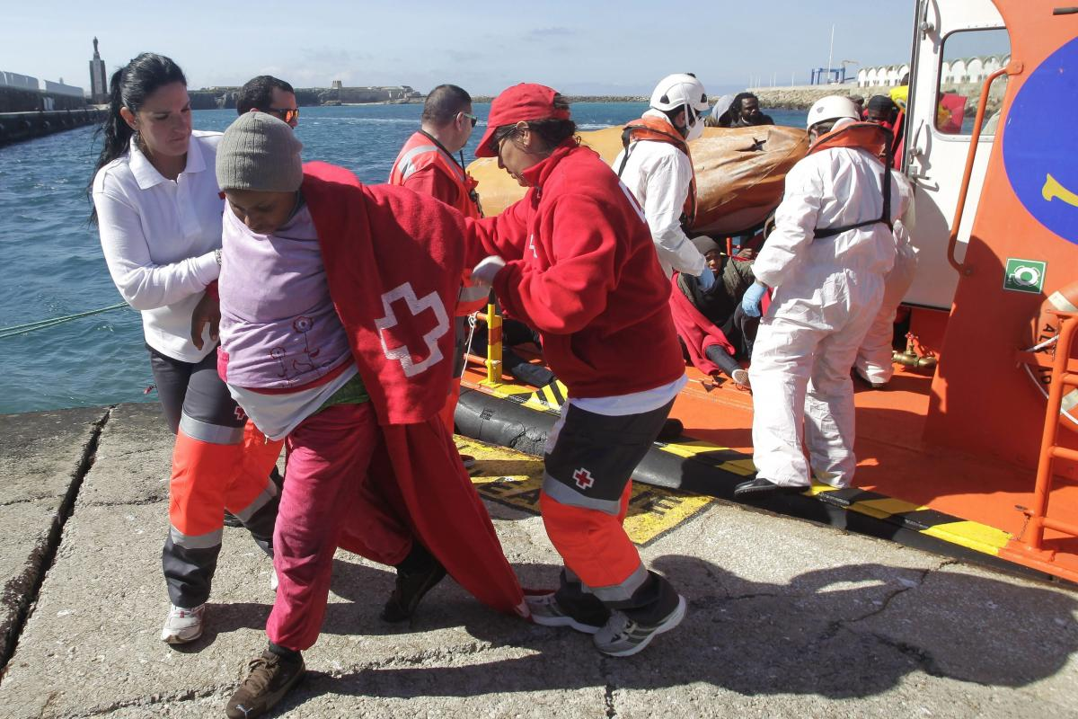 Many pregnant women and children are among the migrants from the Middle East and Africa seeking a better life in Europe. Here, Spanish Red Cross members help a pregnant woman rescued from a small boat traveling near Tarifa port in Cadiz, southern Spain, o