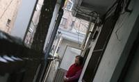 South Korea's Confucian tradition has weakened, and now elderly South Koreans increasingly live alone. In this photo from 2013, Kong Kyung-soon, a 73-year-old who lives alone, looks out of the door of her tiny rented apartment in Seoul.
