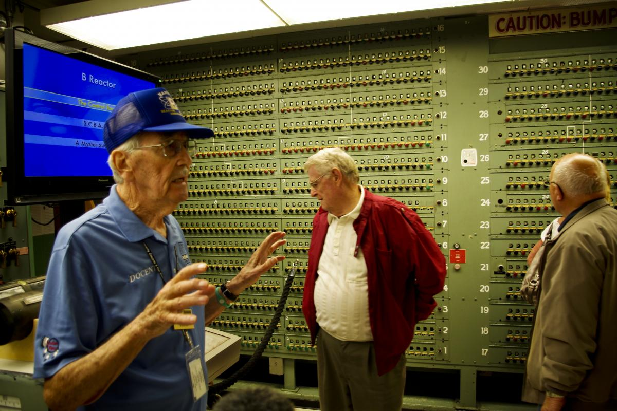 Tour guide Paul Vinther (left) began working at the B Reactor in 1950 and spent 38 years at this and other plutonium-production facilities that sprang up nearby during the Cold War. He also managed the B Reactor when it was shut down in 1968.