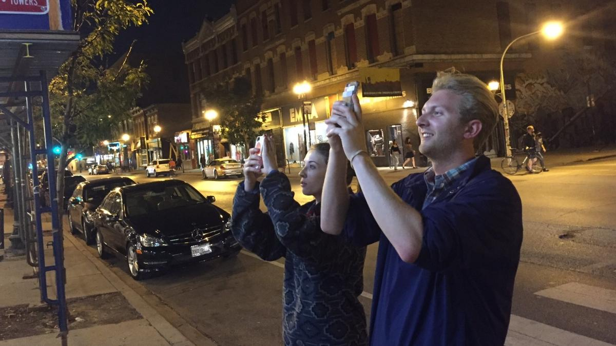 Louise Price and Stanley Opalka, two of the many people taking pictures of the world's first boozy Taco Bell.
