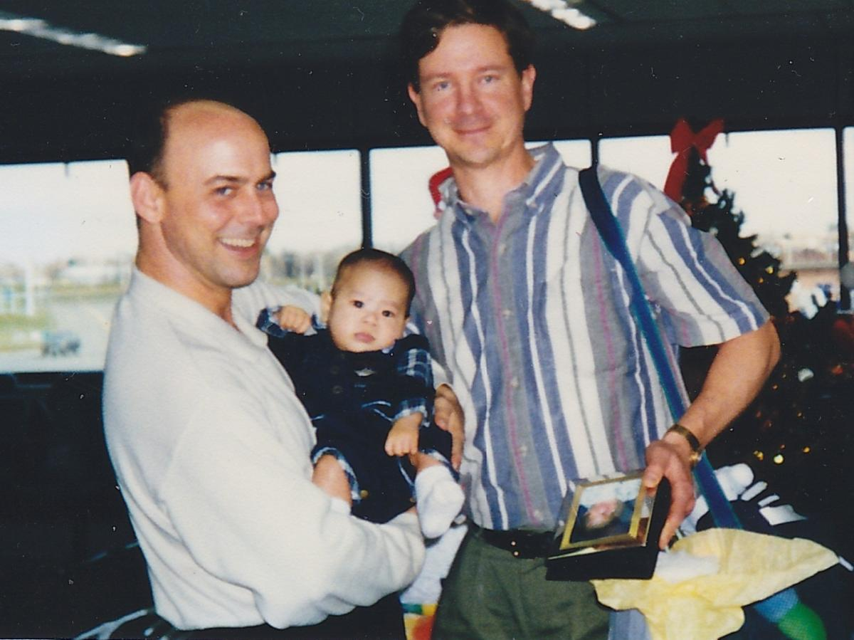 Curtis and David Wikiera arrive home from Vietnam with John in 1998.