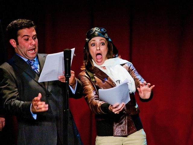 Mark Gagliardi and Autumn Reeser, as aviator Amelia Earhart, perform in The Thrilling Adventure Hour. Actors dress up and read scripts onstage in front of a live nightclub audience.