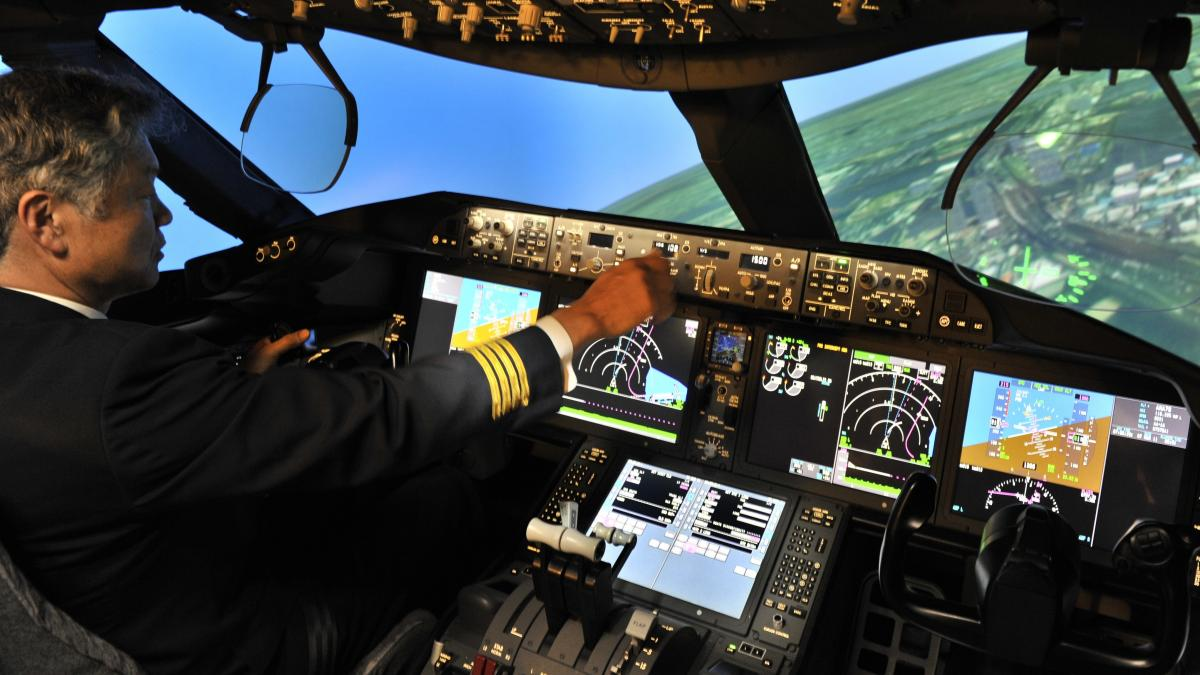 Much of the training for pilots for major airlines is conducted on sophisticated flight simulators, like this Boeing 787 simulator operated by an All Nippon Airways captain. Pilots are also trained to communicate clearly about problems they may encounter