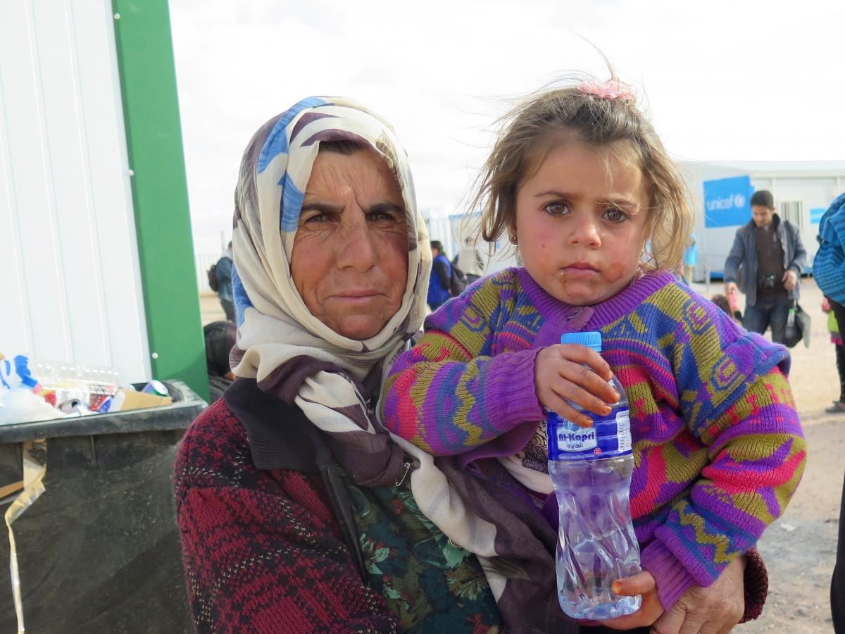 Enshera Mustafa holds her four-year-old granddaughter Nada outside a clinic near the Syrian-Jordanian border. Jordan sealed the border with Syria after a bombing last year and now allows a small number of refugees across for medical treatment before sendi