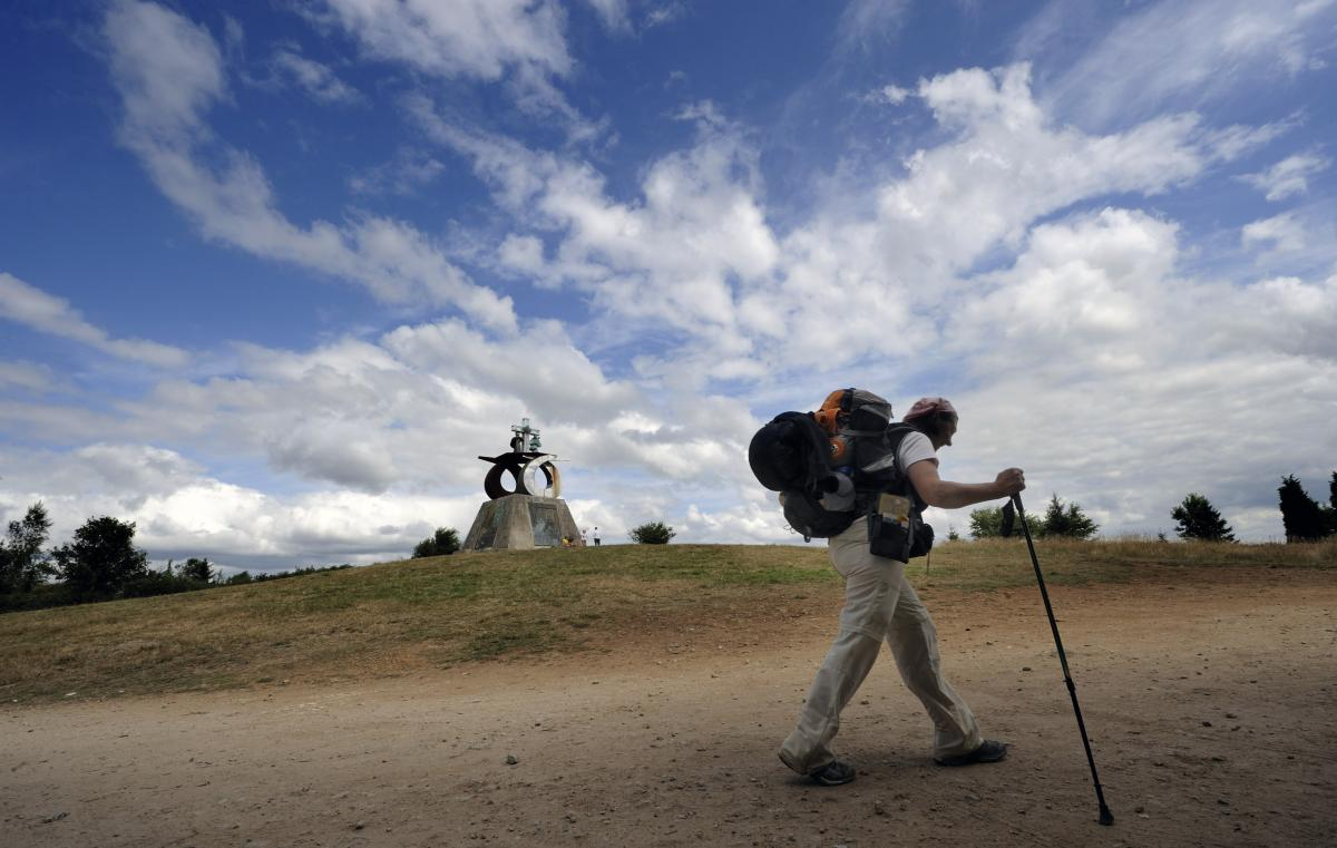 A pilgrim walks the Way of St. James outside Santiago de Compostela, northwestern Spain, on July 21, 2010. The ancient religious pilgrimage is also attracting the nonreligious these days.