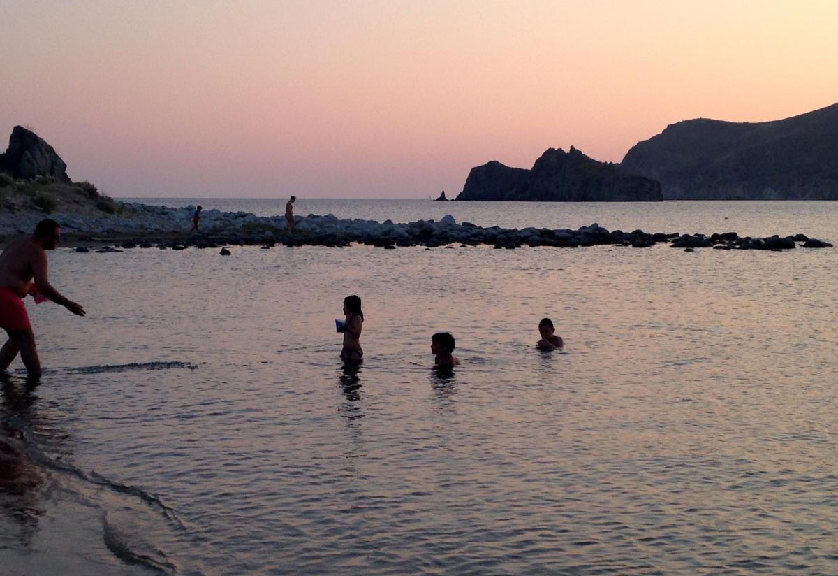 Families play on the beach near the village of Thanos, Lemnos. The island has more than a hundred beaches. Greek tourists like Lemnos because it's affordable and relaxing, and foreign tourists like its unspoiled beauty and traditional charm.