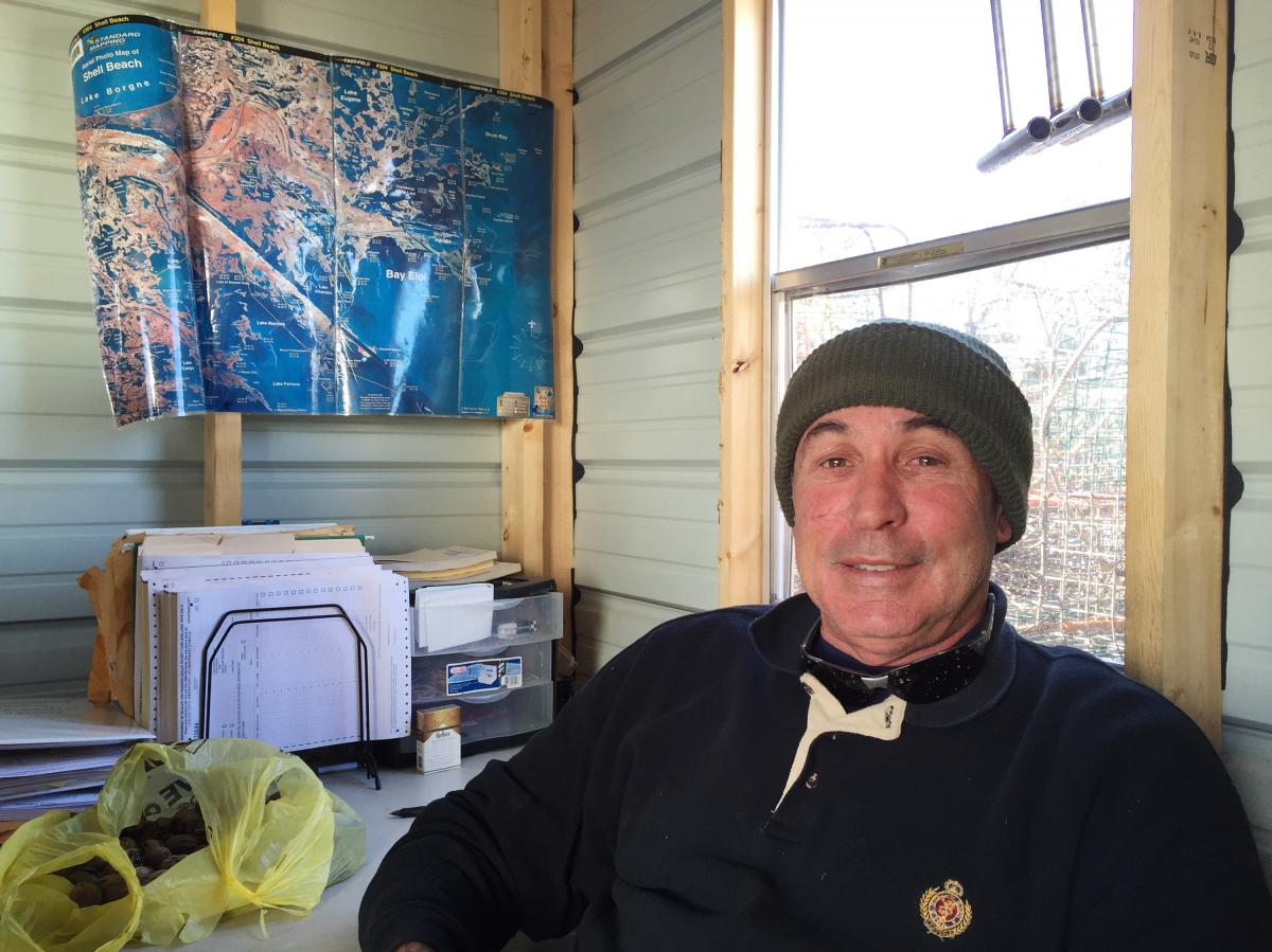 Tony Goutierrez sits inside his office (a trailer on his dock) in Hopedale, La. He says he's having a hard time meeting the demand for Gulf crabs from his longtime customers.