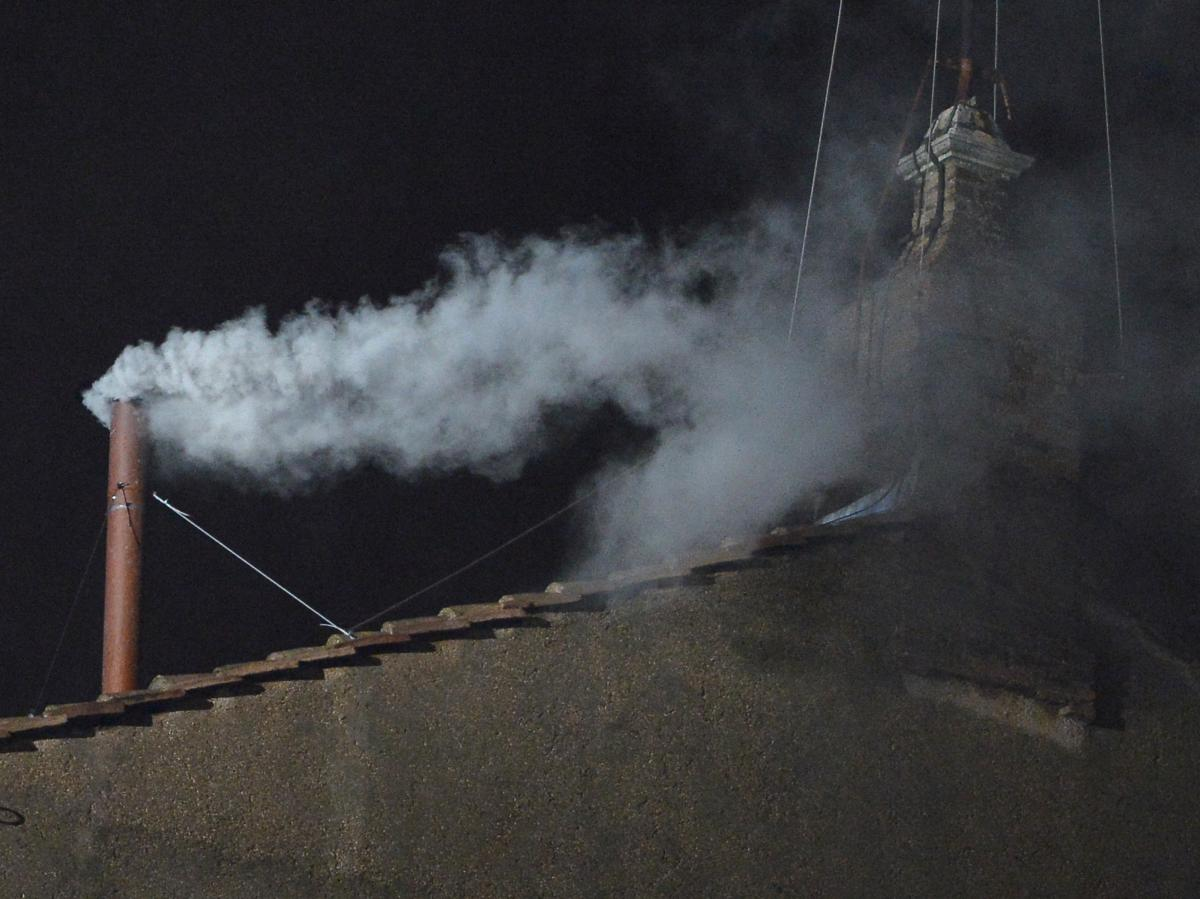 White smoke rises from the chimney on the roof of the Sistine Chapel meaning that cardinals elected a new pope on Wednesday, the second day of their secret conclave on at the Vatican.