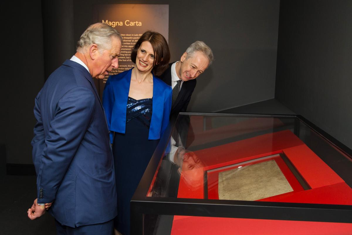Britain's Prince Charles looks at an original Magna Carta manuscript during a visit to the British Library on March 12. The document, which has served as the foundation of the modern judicial system, was issued in 1215 by King John, who was under pressure