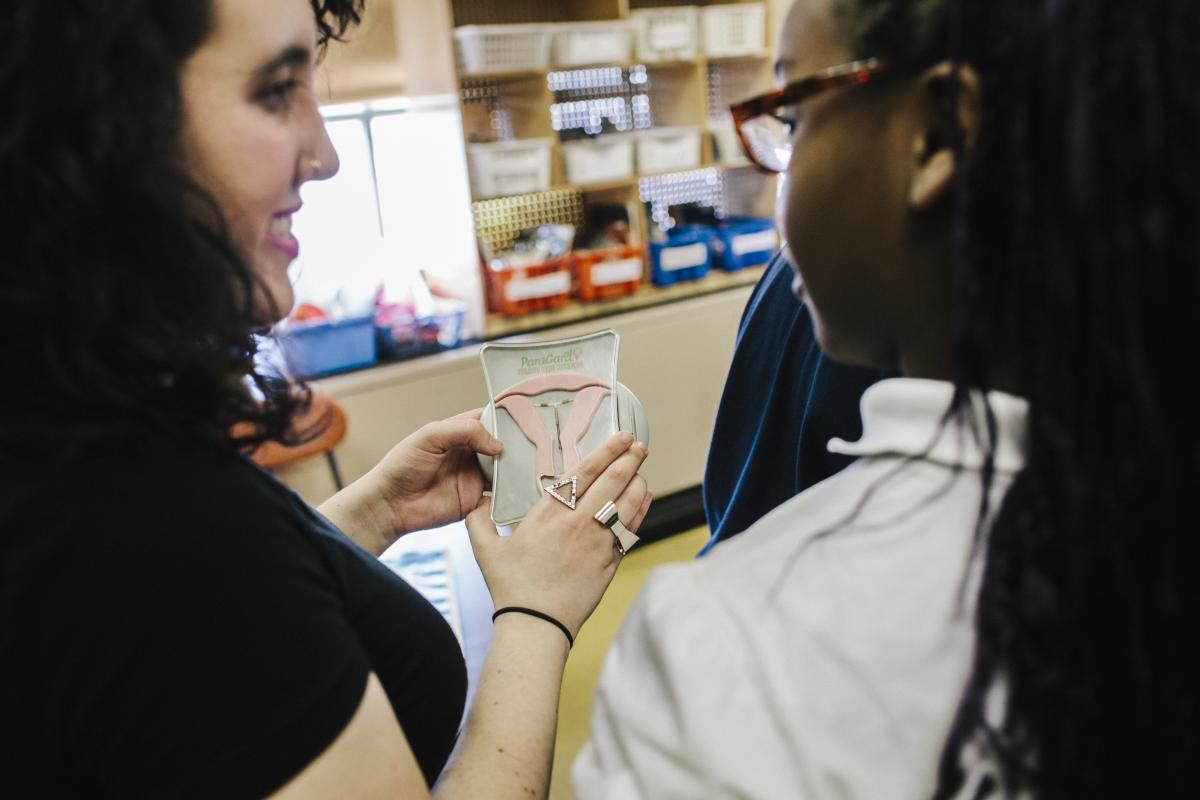 Solow talks to a student about an intrauterine device.