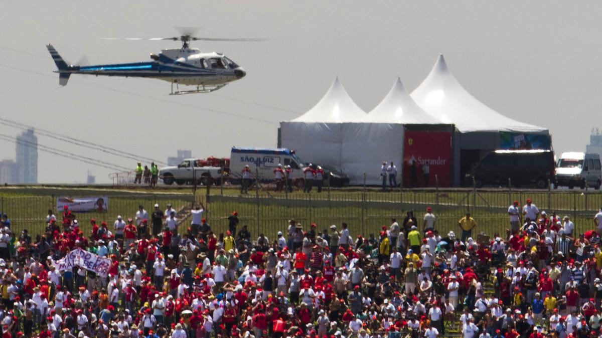 A helicopter carries VIPs to the Brazilian Grand Prix in Sao Paulo in 2010. Politicians taking expensive helicopters and government planes have generated controversy in Brazil.
