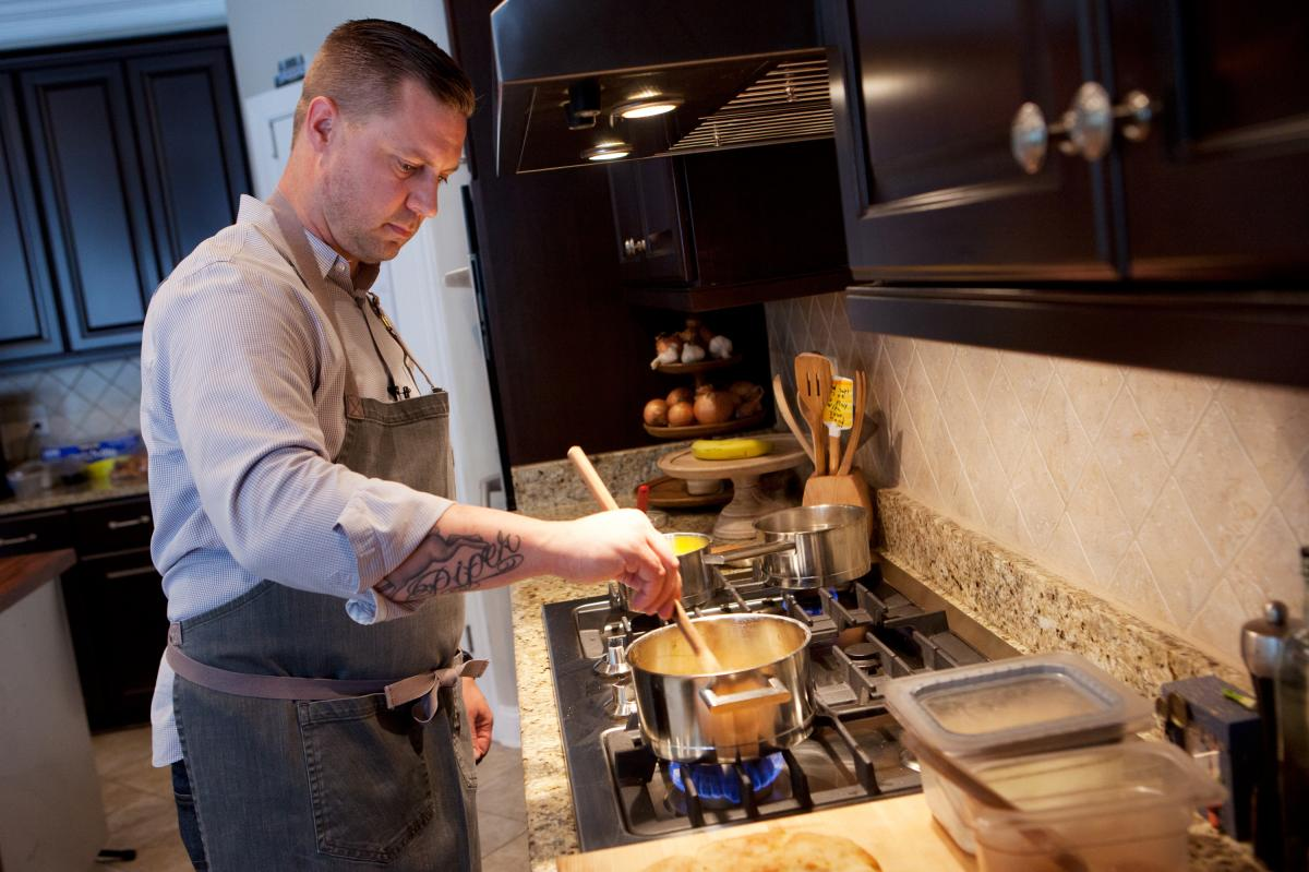 Chef Bryan Voltaggio cooks at his home in Frederick, Md. He has restaurants in and around Maryland and Washington, D.C.
