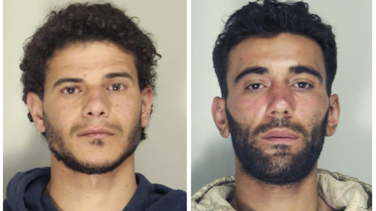 Mahmud Bikhit (left) and Mohammed Ali Malek were arrested and charged with manslaughter and aiding human trafficking; they're seen here in handout pictures released by Italian police in Catania, Sicily.