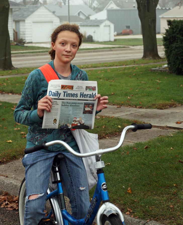 Meridith Beeber on her paper route in Templeton, Iowa, in 2012. Eighty percent of The Daily Times Herald's papers are delivered by young people.