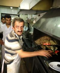 Sabri, a 25-year veteran of the grill, works in the kitchen at Akin Balik restaurant in Istanbul.