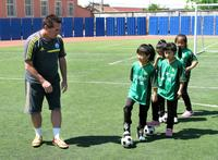American Tom Byer, a former professional soccer player now based in Tokyo, coaches first-grade students at the Nandulehe Elementary School in suburban Beijing. Byer is advising China's government in implementing an ambitious plan to upgrade the country's