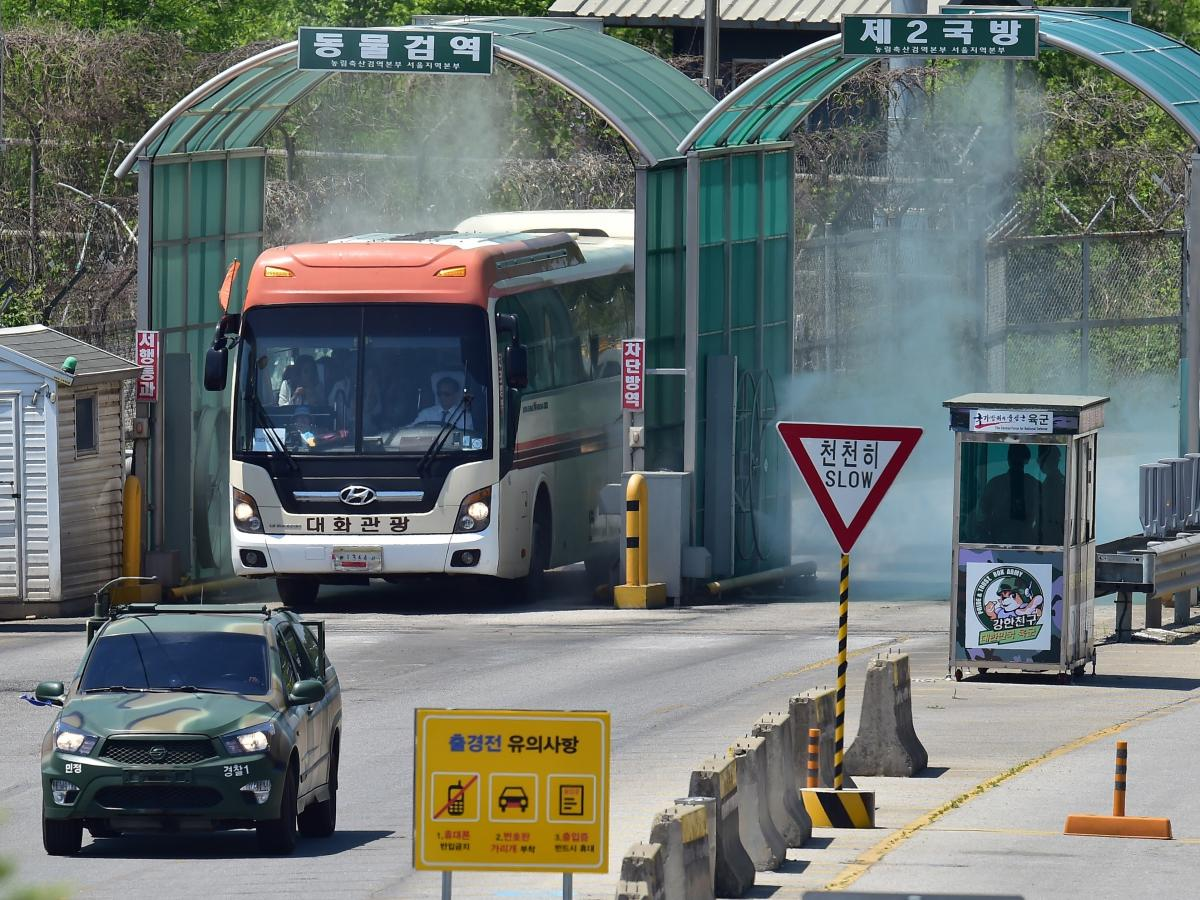 A bus carrying a group of 30 peace activists drives past a military checkpoint after it crossed the border through the demilitarized zone (DMZ) separating the two Koreas.