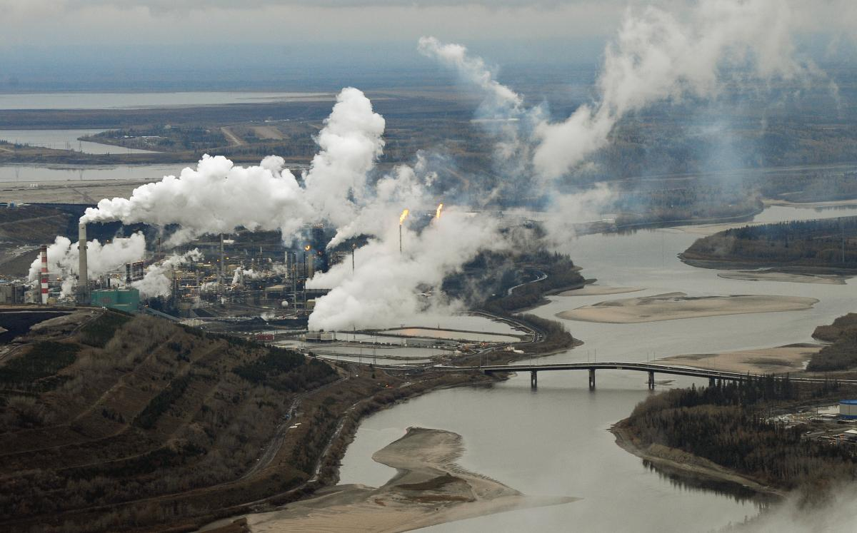 An aerial view of the Suncor oil sands extraction facility on the banks of the Athabasca River in Alberta, Canada, in 2009. Scientists say contaminants found at the bottom of lakes in Alberta are from air pollutants from the facilities responsible for pro