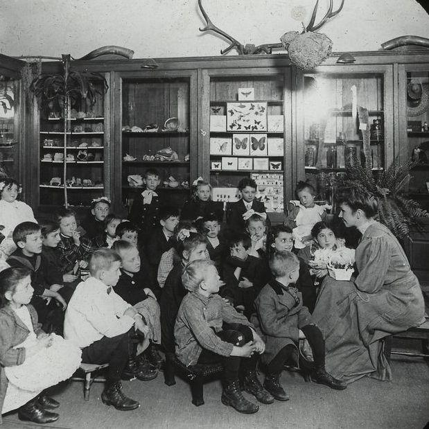 Story Hour at the Carnegie-built Webster branch of the New York Public Library, circa 1910.