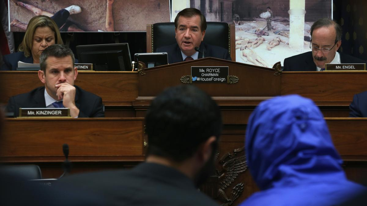 "Rep. Ed Royce (center), R-Calif., speaks during a July 2014 hearing of the House Foreign Affairs Committee, with ""Caesar,"" a Syrian army defector who wore a blue, hooded jacket to protect his identity. Caesar smuggled out of Syria more than 55,000 photogr"