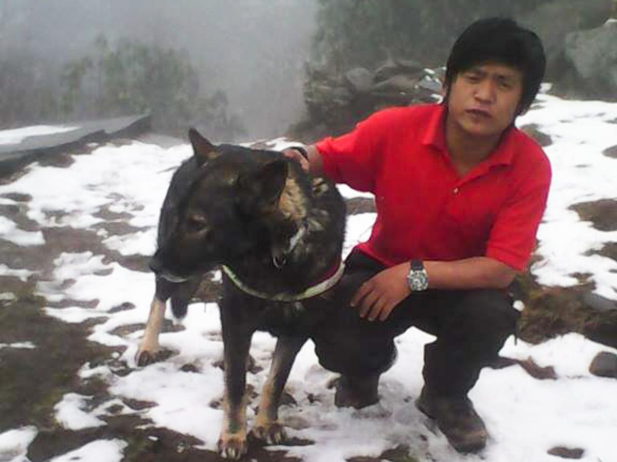 Karna Dura, of SAR Dogs Nepal, is leading the search for Dennis Lee Thian Poh. The team has about 10 men with four dogs.