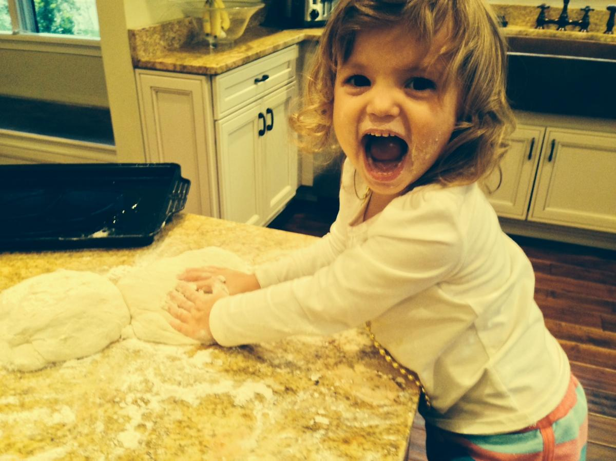 Lilly Symer, 2, helps her mom, NPR reporter Allison Aubrey, make a walnut-based pie crust.