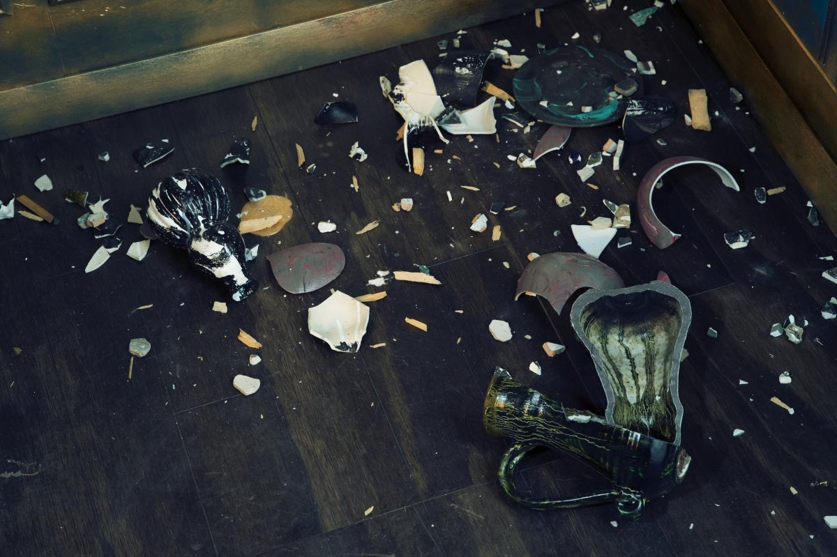 Shards of smashed Asian vases litter the floor of Waterston's Filthy Lucre.