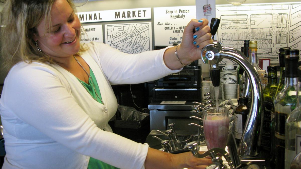 Gina Chersevani makes a Red, White and Blue Float at her restored soda fountain in Washington, D.C.