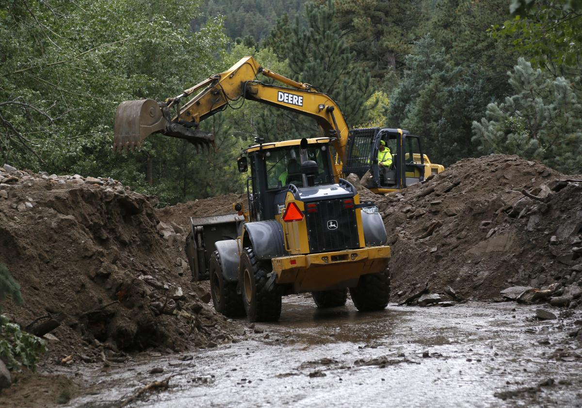 Heavy equipment works to clear a Jamestown road after a landslide covered it with more than 20 feet of mud.