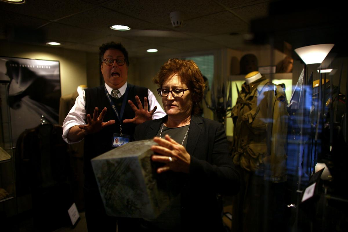 Randall Thropp, a Paramount archivist, recoils in mock fear from the power of the AllSpark as set decorator Rosemary Brandenburg takes it from the glass case. The AllSpark was used as a prop in Transformers; it may have another life in an upcoming sequel.