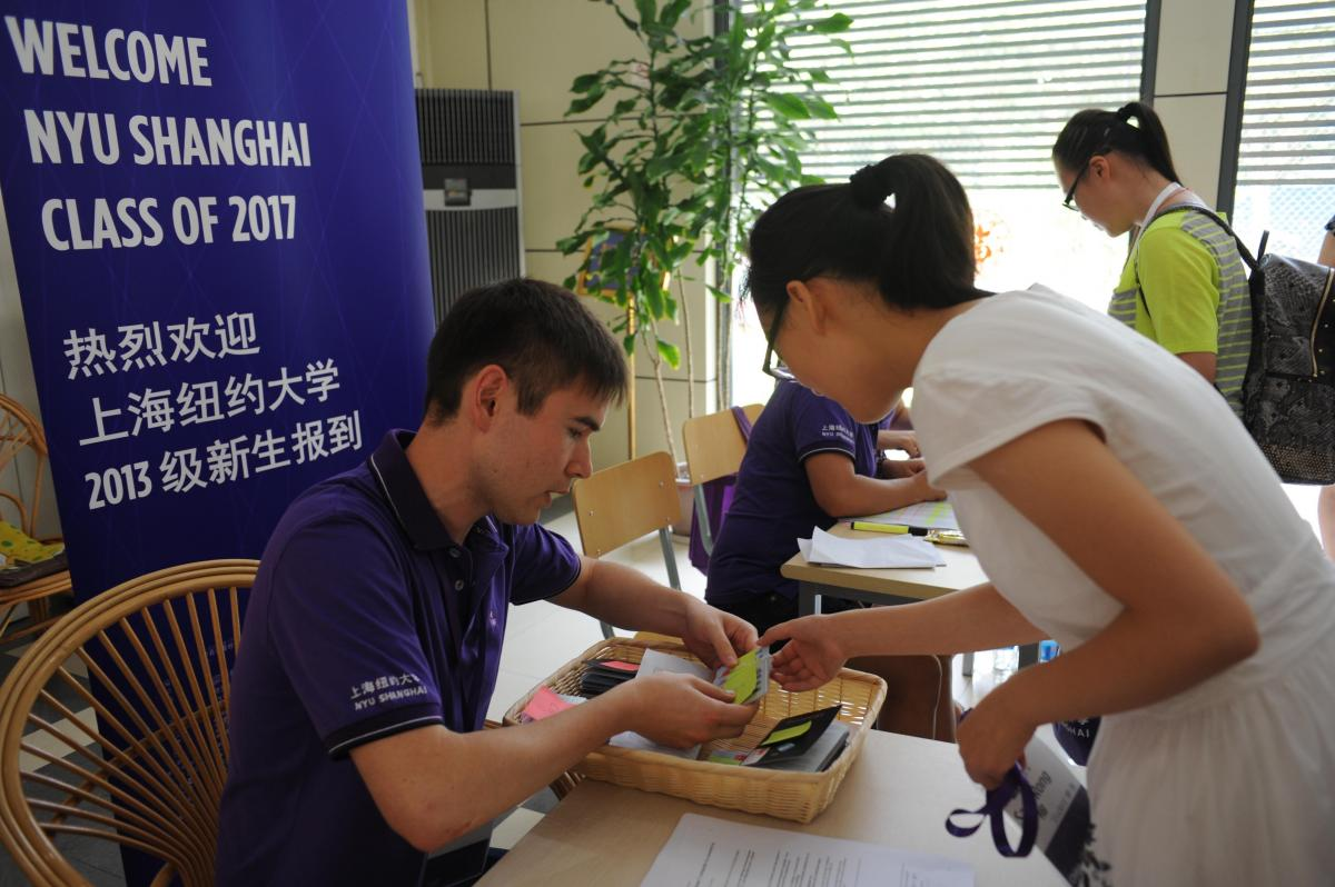 New York University in Shanghai is the first Sino-U.S. joint university. Here, a student speaks with an NYU staffer on Aug. 11.