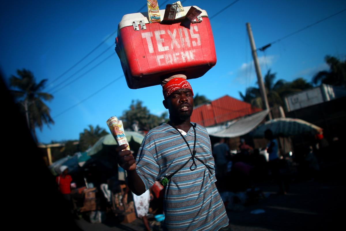 Street vendors peddle cool drinks to drivers stuck in one of the daily traffic jams on Highway 1, which is the main route out of Port-au-Prince, the Haitian capital, to the north. Traffic is one of the obstacles to tourism development in the impoverished
