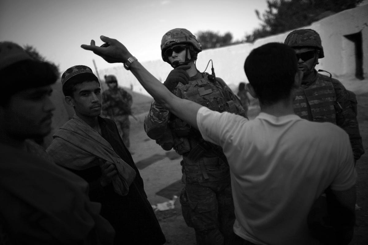 Villagers discuss their grievances with members of the Afghan Local Police and the U.S. military. American soldiers are preparing to hand security responsibilities for the district over to the Afghan army and police. Panjwai is very conservative, and the