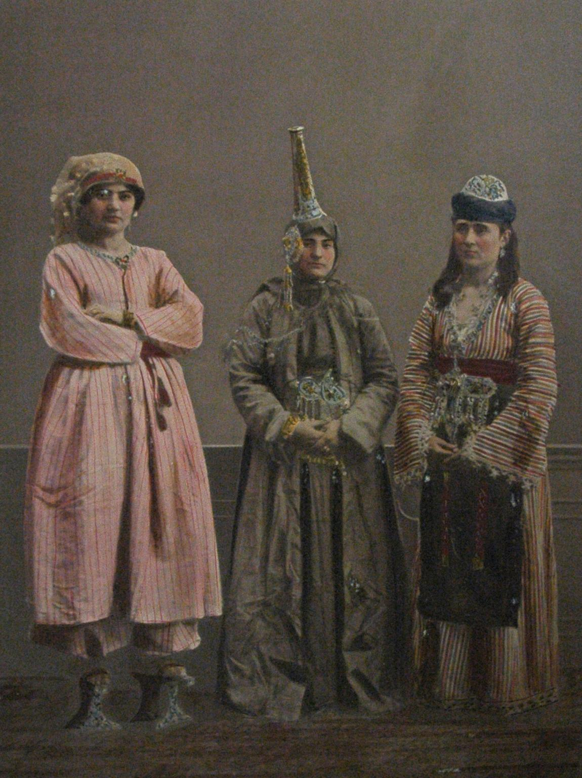 Photographs from a book published by the Ottoman Imperial Commission for the World's Fair in 1873 illustrate Syria's diverse cultures. Here, an Arab woman (left) and a Druze woman (center) stand with another woman; all are from Damascus.