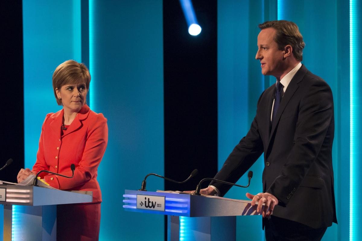 """Sturgeon has delighted the audiences during a series of televised debates. Here, she is seen with British Prime Minister and Conservative leader David Cameron at the first, on April 2, after which newspapers hailed her as """"Queen of Scotland"""" and """"Surgin'"""