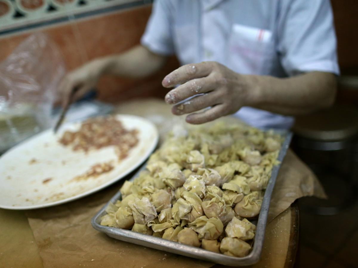 A member of the staff at the one-Michelin-starred restaurant Ho Hung Kee prepares wontons in Hong Kong.