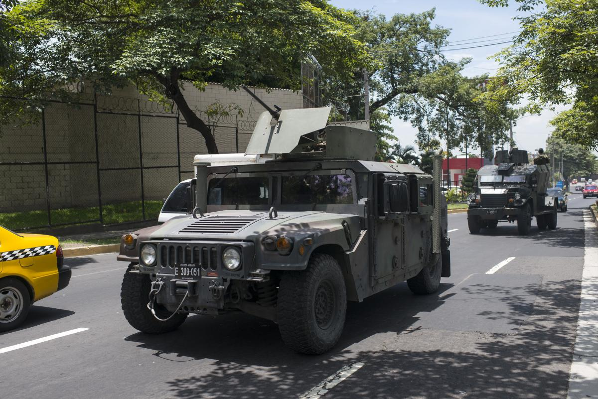 Military vehicles patrolling the streets of San Salvador.