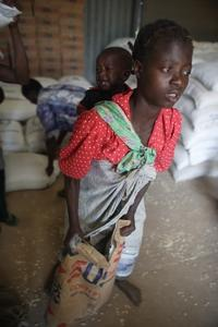 Along with his foundation and his farm, Howard Buffett uses photography to raise awareness of hunger issues. In 2006, he photographed a girl receiving food aid at a World Food Program distribution site in Malawi, where 5 million people needed emergency fo