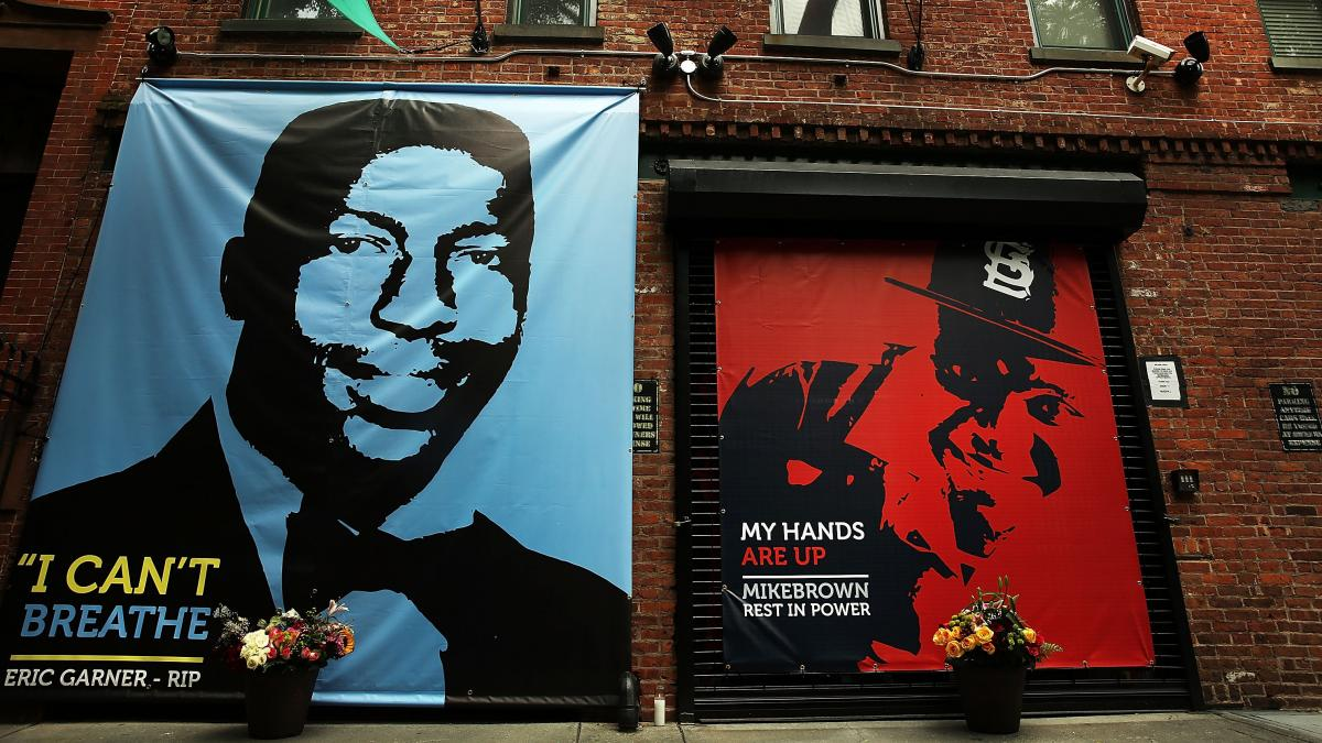 A memorial to Michael Brown sits next to one honoring Eric Garner outside filmmaker Spike Lee's offices in Brooklyn. This summer, the deaths of both unarmed black men set off numerous demonstrations in their communities, but the peaceful protests in New Y