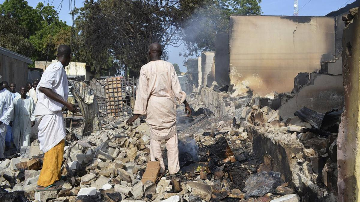 Men walk amid rubble after Boko Haram militants raided the town of Benisheik in northeast Nigeria, on Sept. 19. The Islamist group has been waging an insurgency in northern and central Nigeria for the past four years and was recently placed on the U.S. li