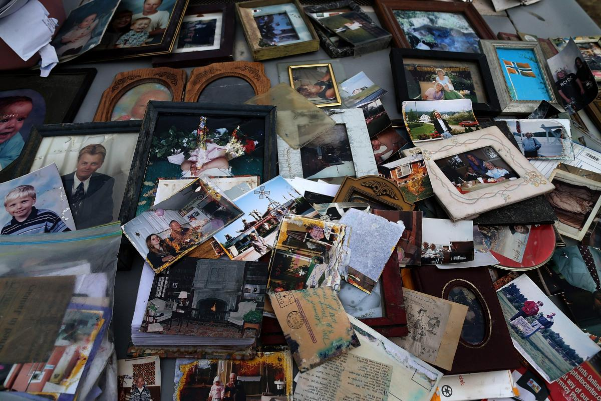 Old photographs are laid out on a car hood to dry after being removed from a flooded home in Seaside Heights, N.J. At the time, New Jersey Gov. Chris Christie estimated that Superstorm Sandy had cost his state $29.4 billion in damage and other economic lo