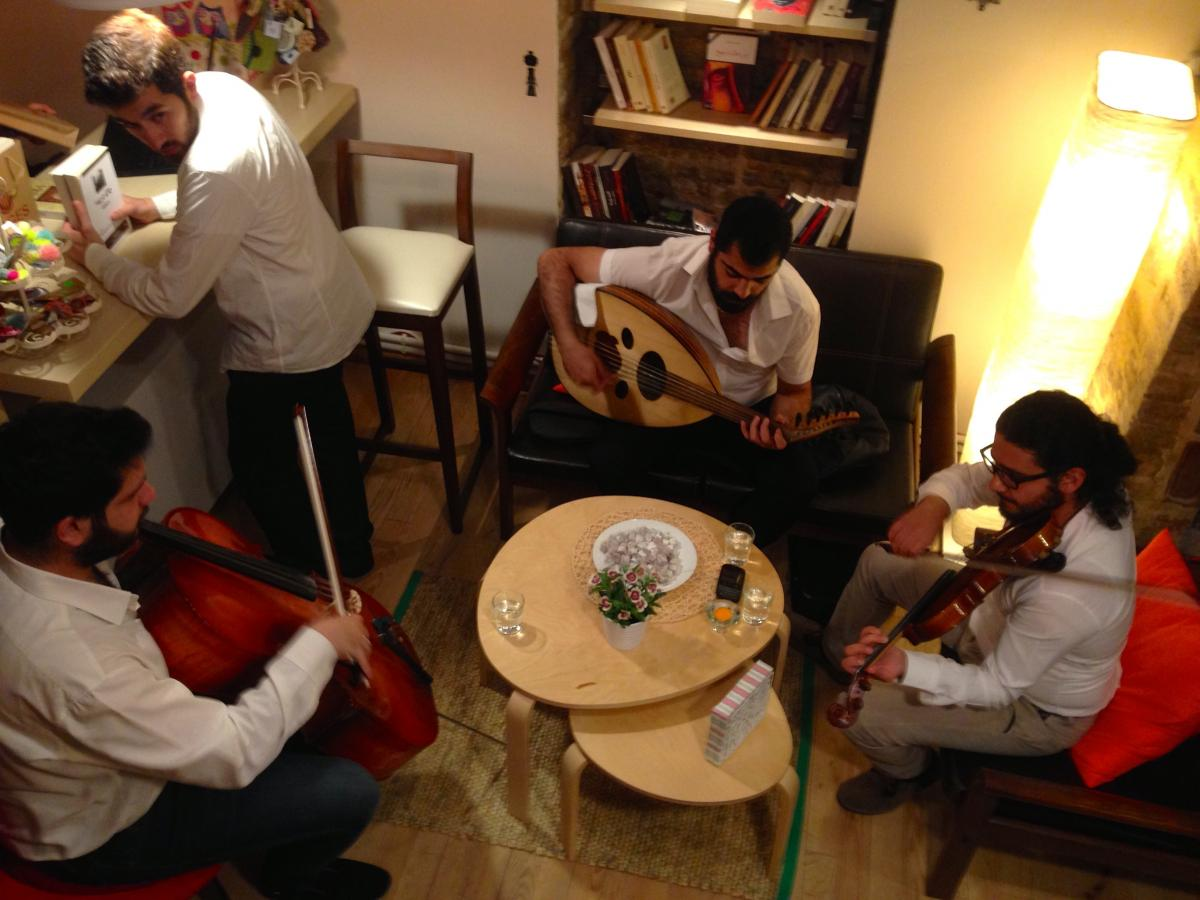 A trio of Syrian musicians performs at the opening of Pages bookstore in Istanbul. The store has a cafe and a play area for children, and owners hope to host movie screenings and workshops.