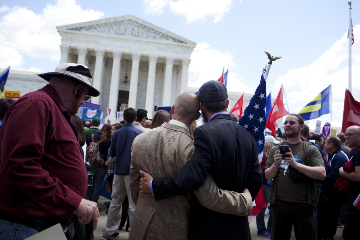 Frank and Joe Capley-Alfano embrace as the plaintiffs leave the Supreme Court on Tuesday. They were remarried in 2008 after their 2004 marriage license was voided by the California Supreme Court.