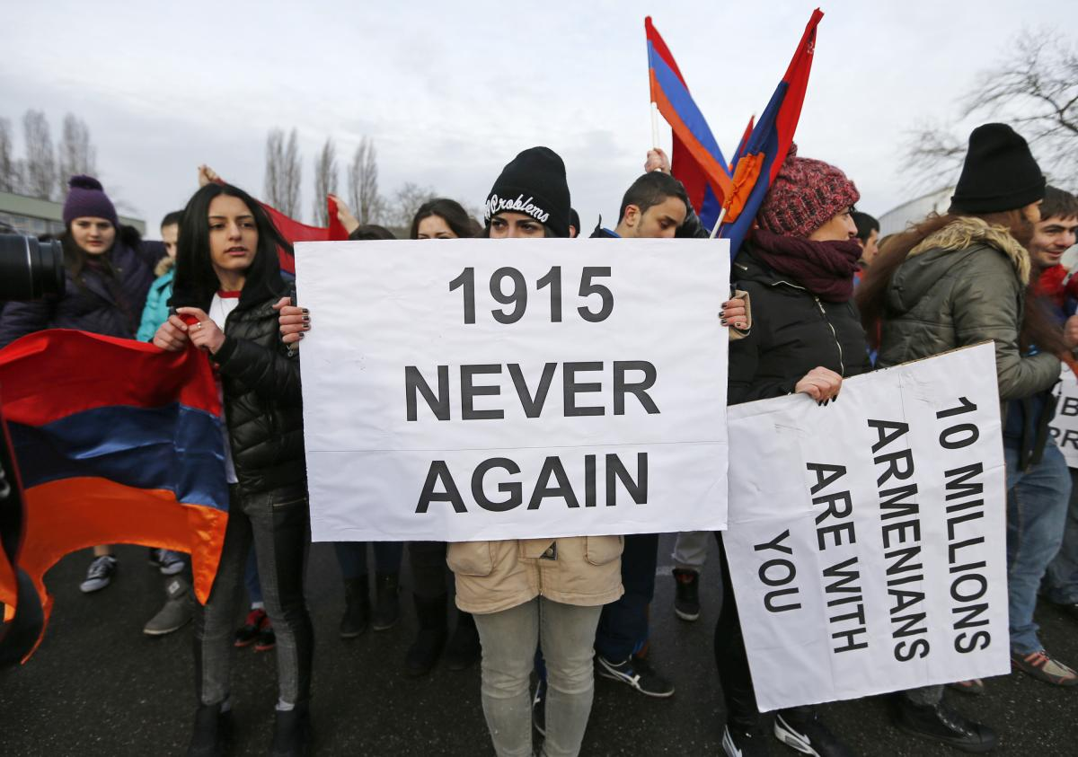 """An Armenian protester holds a sign reading """"1915 never again"""" during a demonstration near the European Court of Human Rights in Strasbourg, France, on Jan. 28."""